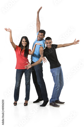 Happy group of Indian friends. isolated over white