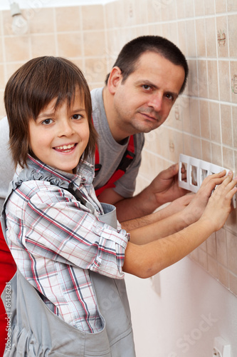 Working with dad - boy helping his father
