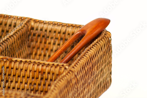wooden hairgrip in the braided rattan pannier
