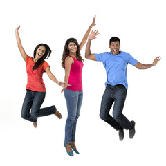 Excited group of Indian men and women jumping for joy.