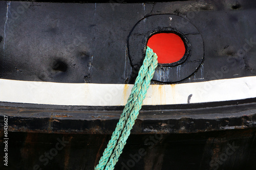 tug ship docked with rope