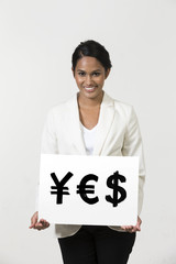 Indian business woman holding currency symbols saying word 'YES'