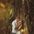 couple kissing in mysterious forest (bali, indonesia)