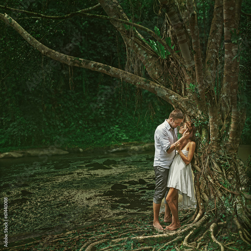 Beautiful couple in dramatic forest