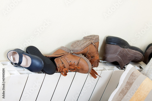 pairs of shoes on   radiator