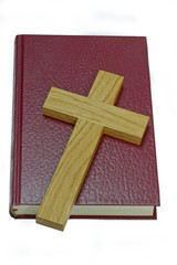 Wooden Cross on an Antique Bible