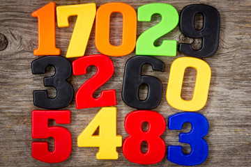 Plastic numbers on the wooden background