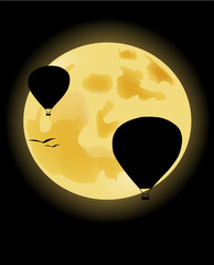 Balloons on the background of the full moon
