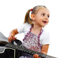 Little smiling girl playing guitar