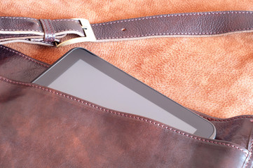 Leather handbag with tablet inside