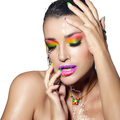 Fashion Girl Portrait. Colorful wet Makeup. Beauty and Fashion