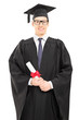 Young male college graduate posing with diploma in hand