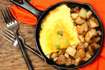 Denver Omelette and Ranch Potatoes in Cast Iron Skillet on Table