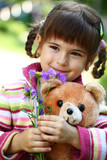Little girl with bear