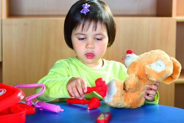 Little girl with bear
