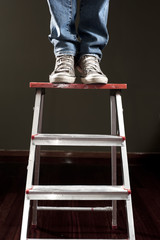 Man standing on ladder