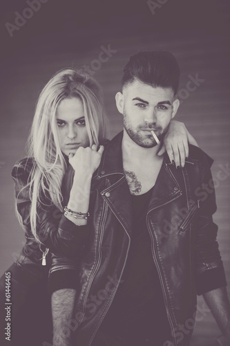 retro rock fashion couple smoking cigarette