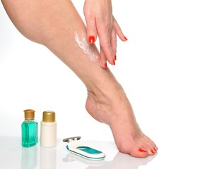 Female legs and items for foot care and body care