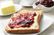 coffee and toasts with butter and jam