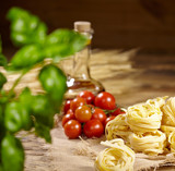 Italian food background, with vine tomatoes, basil, spaghetti