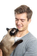 young man with siamese cat