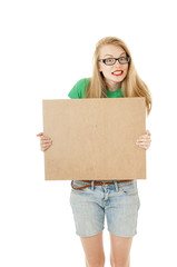 Happy young girl holding empty wooden notice board and wearing e