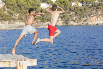 summer camp kids jumping in sea