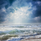 Fototapety dark sky on a stormy sea