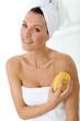 Attractive woman in bathroom using sponge