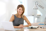 Portrait of businesswoman working on laptop