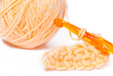 skein of orange yarn closeup and crocheting knitting