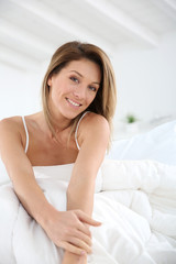 Middle-aged woman laying in bed