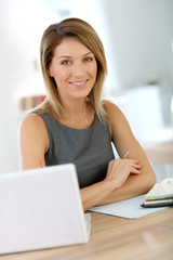 Portrait of businesswoman working on laptop