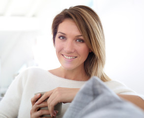 Portrait of middle-aged woman relaxing at home