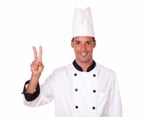 Alone professional chef with victory sign