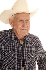 Elderly man cowboy close look side
