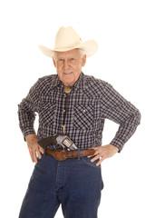 Elderly man cowboy pistol in pants