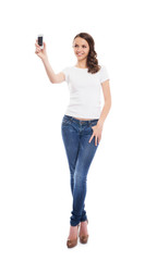 A young and attractive teenage girl with a mobile phone isolated