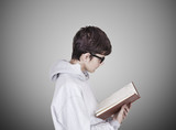 portrait of young caucasian close-up reading book