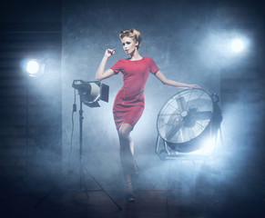 A woman in fashion dress over glamour background