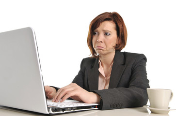 sad business red haired woman in stress at work with computer