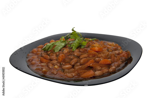 Plate of baked beans isolated on white