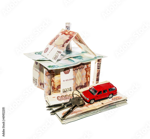 House made of banknotes with a toy car and a bunch of keys