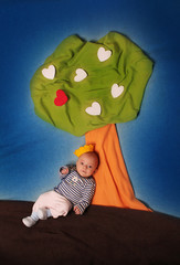 little prince sitting under a love tree