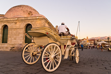 Horse carriage in Chania harbor at sunset, Crete