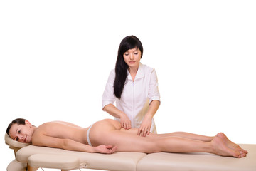 masseur makes cellulite massage