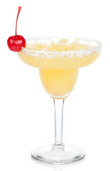 Yellow margarita cocktail with red cherry in chilled salt rimmed