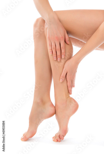 Woman touching hands and legs