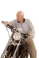 Elderly man on motorcycle look side