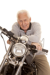 Elderly man on motorcycle close smile